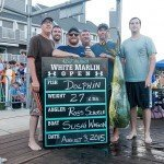 Six guys standing with their Mahi dolphin during white marlin open day