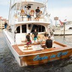 Team standing on the Goin in Deep fishing boat in Ocean City MD