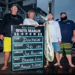 Guys standing with their mahi mahi during evening time in Ocean City MD