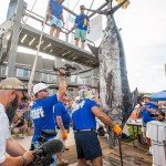 Lifting up a massive white marlin over a dock during white marlin open 2015