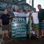 10 guys standing around their mahi mahi dolphin caught during White Marlin Open 2015