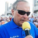 Speaker for 2015 White Marlin Open talking into a microphone in OC MD