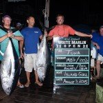 Group of 4 holding their large tunas during white marlin open 2015