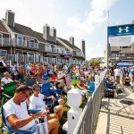 Crowd of people sitting in their chairs at the dock during White Marlin Open 2015