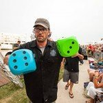 Guys holding big blue and green dice during White Marlin Open 2015