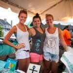 Three women smiling at the camera in a shop during White Marlin Open 2015