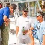 Three guys talking on a boat during White Marlin Open 2015