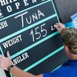 White marlin open 2015 staff member writing the weight of a tuna on a chalk board