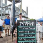 Angler Cheryl McLeskey standing with her white marlin in Ocean City MD