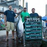 Crew of the Canyon Runner 48 standing with their tuna during white marlin open