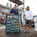 Two guys standing with their wahoo fish during white marlin open 2015
