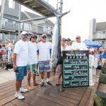 Crew of the Backlash boat standing around their white marlin in Ocean City MD