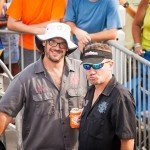 Two guys smiling for the camera during white marlin open 2015