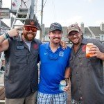 Three guys wearing hats all smiling for the camera during white marlin open 2015
