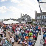 Fish eye photo of a group of people sitting and standing during white marlin open 2015