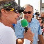 Woman talking in a green capped microphone during White Marlin Open 2015