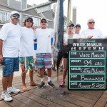 Family and friends standing around their 94 pound white marlin in OC MD