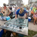 White Marlin open 2015 staff member filling out a chalk board with information about the fish