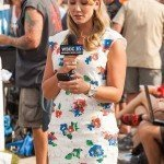 WBOC news reporter standing at white marlin open 2015 looking at her phone