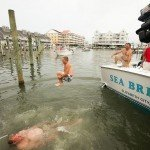 Man doing a cannon ball into the water in Ocean City MD