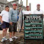 Crew of the Just Right V with their small wahoo fish in Ocean City MD