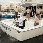 Crew of the Two Suns fishing boat leaving dock in Ocean City MD