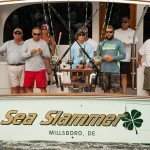 Crew of the Sea Slammer standing on the stern of the fishing boat in Ocean City MD