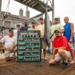 Crew of the Sea Breeze fishing boat around their white marlin caught in Ocean City MD