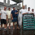 Crew of the Two Timing Connie fishing boat with their tuna in Ocean City MD