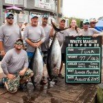 Crew of the Amanda May-Hem fishing boat with their two tuna caught during white marlin open