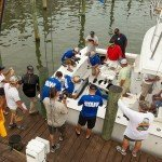 Aerial shot of the staff members measuring a white marlin on a fishing boat in OC MD