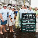 Crew of the Streaker fishing boat surrounding their mahi mahi in Ocean City MD