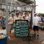 Two Suns fishing boat crew standing with the white marlin they caught in Ocean City MD
