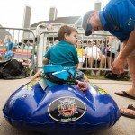 Small boy sitting a blue inflatable toy during white marlin open 2015