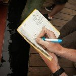 Yellow notebook used to record results during white marlin open 2015