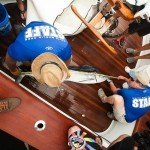 Aerial view of two staff members measuring a white marlin on a fishing boat in OC MD